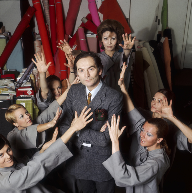 Fashion designer Pierre Cardin stands in his studio surrounded by models. (Photo by Pierre Vauthey/Sygma/Sygma via Getty Images)