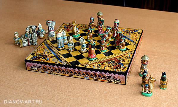 Доска для игры украшена национальным орнаментом, фигуры изготовлены из керамики и расписаны вручную